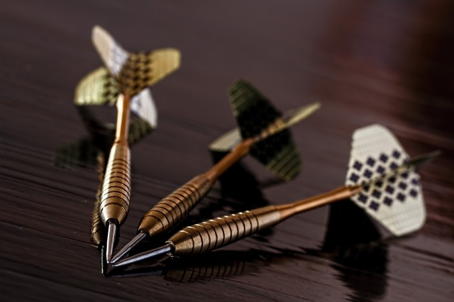 Three darts over a table
